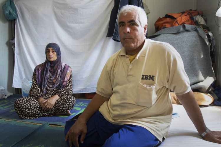 LESVOS, GREECE  06/05/2017: Abdul Kaoud, a Syrian refugee who fled war-torn Syria over a year ago with his family, sits in his trailer at the Kara Tepe refugee camp in Levsos, which houses roughly 1,200 asylum seekers in tightly packed rows of shipping containers converted into family dwellings. Asylum seekers here face many challenges such as inadequate access to electricity and water, restrictions on employment and educational opportunities, lack of targeted mental health interventions for youth, and poor access to legal advice. However, the non-profit Movement on the Ground, has made efforts to build a more self-sufficient community-like atmosphere, and has worked to improve conditions here.