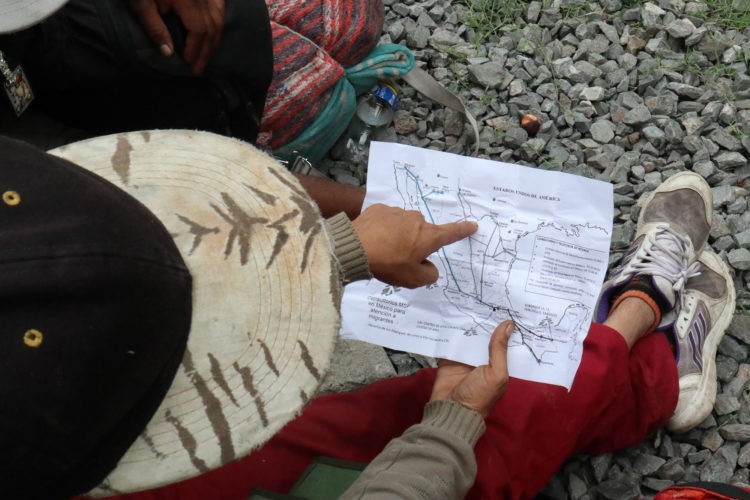 """GUADALAJARA, MEXICO  07/11/2017: Enrique, a migrant from Honduras, uses a map given to him by a local shelter in Guadalajara which outlines the various freight train routes migrants can use on their journey to the United States to more quickly traverse the length of Mexico. This mode of travel is extremely dangerous and illegal. Guadalajara, roughly the midway between Central American and the U.S. border. Enrique says this this his 4th attempt to make it into the U.S., previous attempts resulted in being deported back to Honduras. If he makes it across, he plans to look for his a half-sister living in Trenton, NJ.The journey to the United States is often long and involves several steps. Before migrants can get on the train they must travel from their homes through Central America to the Mexican border. Crossing the border is relatively easy as, even with increased surveillance, it is lightly patrolled and wide sections remain porous. Once in Mexico, migrants must then travel on foot or by vehicle to the nearest train terminal, where, usually after paying bribes or protection fees, they climb atop a railcar to start the first leg of their journey north. The travelers frequently change train lines along the way, often stopping at shelters run by civil-society organizations. Once they near the U.S. border migrants disembark and pay a smuggler (known as a """"coyote"""") to enter the United States. As the trains are subject to inspection and surveillance close to the border, it is nearly impossible for a migrant to cross the U.S.-Mexico border aboard the train."""