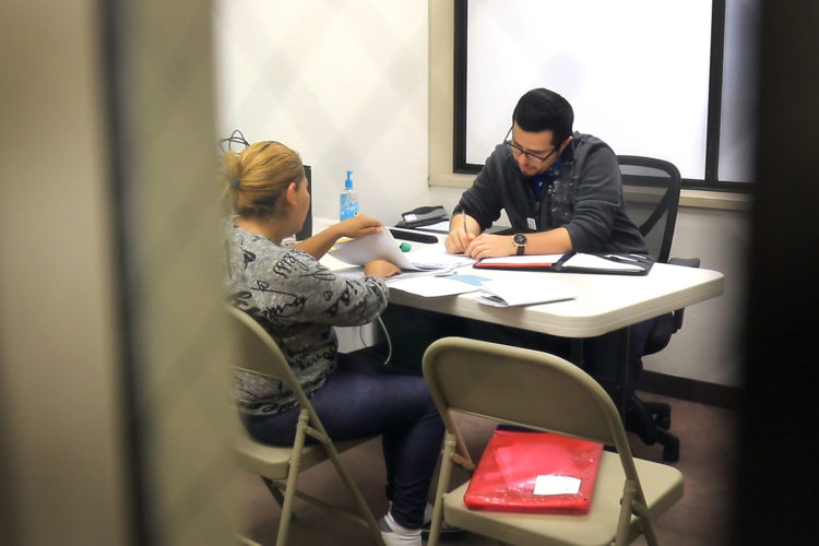 "SAN DIEGO, CA  03/11/2019: Luis Gonzalez, an attorney who assists asylum seekers near the U.S.-Mexico border, meets with a client from Central America seeking asylum in the U.S. inside an office in the temporary emergency shelter in San Diego. Gonzalez is the ""Border Fellow"" for the Hebrew Immigrant Aid Society (HIAS), part of their response to the crisis at the southern U.S. border. He has been working at Jewish Family Services, a HIAS affiliate, since the fall of 2018. He meets daily with clients either in the ICE detention center, temporary shelter, or in his office, and assists migrants navigate the asylum process.