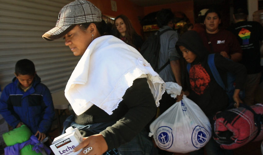 TIJUANA, MEXICO  03-09-2019: Isabela Murillo carries supplies given to her by the Border Angels volunteers brought them clean clothes, shoes, and hygiene products then helped them get to the nearby shelter, where they would spend the night before trying to apply for asylum in the U.S.