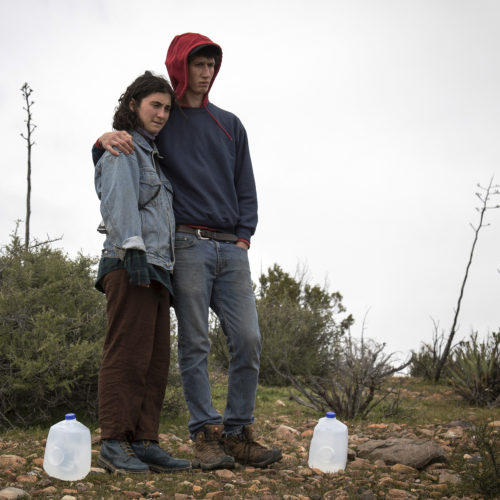 "IMPERIAL COUNTY, CA 03/10/2019:  Amba Guerguerian and Wes Markusfeld were part of a Border Angels team of volunteers that carried gallons of water into the Imperial Valley in southeastern Southern California near the Mexico border and hid the plastic bottles scattered along trails that undocumented migrants often take after crossing into the California.  Along the trails, discarded items such as makeshift foot coverings migrants use to avoid leaving footprints could be seen as well as other discarded clothes and remnants of campfires. The conditions here are extreme, often were windy and cold at night, and extremely ward during the daytime. Border Angels is a nonprofit that has been leading humanitarian efforts such as ""water drops"" in the desert for migrants for over 20-years. In 2019, two border aid volunteers were sentenced to 15 months of probation, must pay fines for dropping off water and food intended for migrants crossing through a protected desert area in southern Arizona."