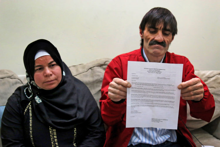 ELIZABETH, NJ   04/03/2016: Fadel and Maryam El Radi were served a bill for $6,742 from the International Rescue Committee (IRC) informing them they must begin  to repay the travel debt for their family's airfare to the U.S. The AL Radi's fled their home in Daraa, Syria, after it was badly damaged by aerial bombings in which wife Maryam was injured. They then fled to Jordan, where they were remained for 3-years before being resettled in Elizabeth by the IRC. The Al Radi's have 4 children, all are unable to speak English, and they have struggled to secure steady work, so paying off this considerable debt has them very worried. Kate McCaffrey of Bnai Keshet in Montclair led a go fund me, and quickly raised the money to pay off the debt.