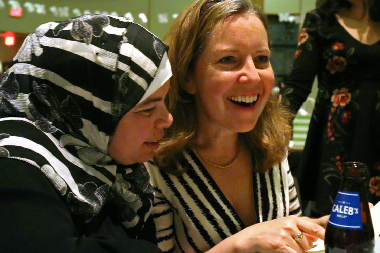 MONTCLAIR, NJ   04/23/2016   SYRIAN REFUGEE FAMILIES RESETTLED IN ELIZABETH/ COMMUNITY SEDER:  Kate McCaffrey of the Bnai Keshet Synagogue, attempts some Arabic phrases with Maryam Al Radi. The two have become very close in the few months they have known each other, despite cultural and language differences. The Bnai Keshet congregation invited the Al Radi family, who are Muslim, to their community Seder for Passover.