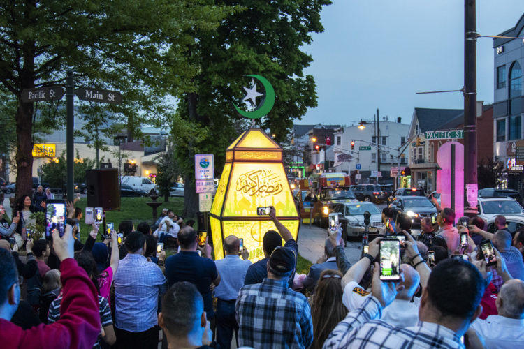 "PATERSON, NJ  05-04-19: At dusk on the eve of Ramadan a giant fanous, or lantern, was illuminated at the South Paterson Park on Main Street to usher in the holy month. After a ceremony led by Andre Sayegh, the city's first Arab-American mayor, people gathered to have their photo taken. 6th Ward Paterson Councilman Al Abdellaziz, who helped start the tradition four years ago, said, ""We want this to become a destination, ""it's like the Muslim Rockefeller Center Christmas tree."""