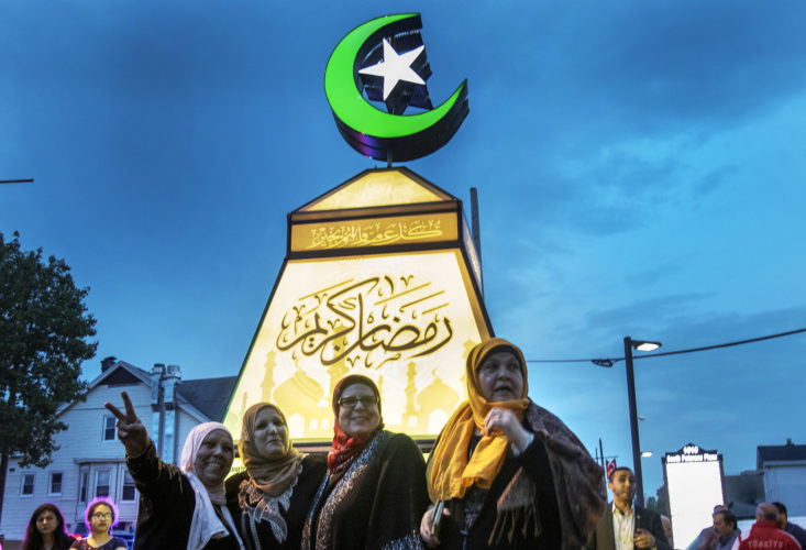 "PATERSON, NJ  05-04-19: A group of Muslim women pose for Instagram photos with the giant fanous, or lantern, illuminated at the South Paterson Park on Main Street to usher in the holy month of Ramadan. After a ceremony led by Andre Sayegh, the city's first Arab-American mayor, people gathered to have their photo taken. 6th Ward Paterson Councilman Al Abdellaziz, who helped start the tradition four years ago, said, ""We want this to become a destination, ""it's like the Muslim Rockefeller Center Christmas tree."""