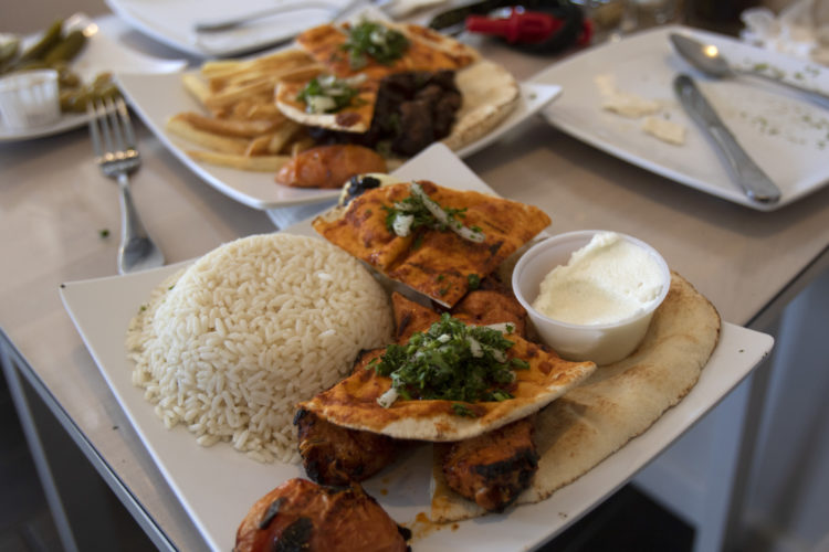 04-17-19 PATERSON, NJ:  A mixed dish is served at Nouri.Cafe, a Mediterranean corner-cafe on Main Street in South Paterson that specializes in Middle Eastern brick-oven baked goods as well homemade grilled specialities, salads, and sandwiches.
