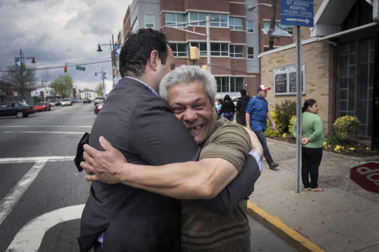 04-17-19 SOUTH PATERSON PROJECT/ MAYOR ANDRE SAYEGH:  Paterson mayor Andre Sayegh gets a big hug from a city resident. Sayegh is the first Arab-American to lead the city, which has had a long-thriving Middle Eastern immigrant community in the southern district of the city known as South Paterson. Sayegh's was born to a Syrian mother and a Lebanese father, and is Christian, was a longtime city councilman and was elected mayor in 2018.