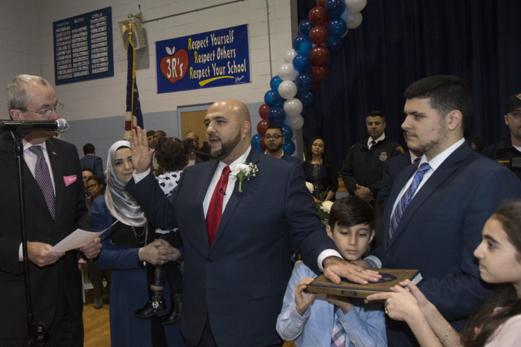 "PROSPECT PARK, NJ  01-05-2019: Mohamed T. Khairullah was sworn-in by NJ Governor Phil Murphy after being elected to his fourth term as mayor of Prospect Park, NJ . Khairullah, who was born in Syria and came to the US as a refugee has become an outspoken leader in the Syrian-American community in here in the U.S. and abroad. ""Act Locally, Think Globally"" was his main slogan during his recent re-election campaign. In addition to the governor, the ceremony was attended by roughly 250 people at Prospect Park School #1, including many several elected officials from around the region the Turkish Consul General was in attendance.